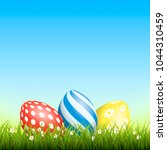 easter background with eggs in... | Shutterstock .eps vector #1044310459