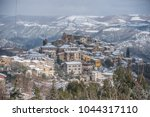 ancient snow covered medieval... | Shutterstock . vector #1044317110