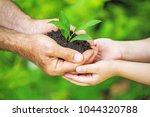 child and senior man holding... | Shutterstock . vector #1044320788