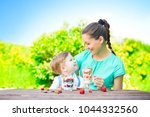 beautiful happy mother and her... | Shutterstock . vector #1044332560