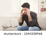 young man suffering from... | Shutterstock . vector #1044338968