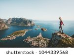 woman traveler standing alone... | Shutterstock . vector #1044339568