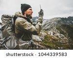 man traveler using smartphone... | Shutterstock . vector #1044339583