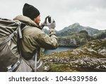 man traveler checking... | Shutterstock . vector #1044339586
