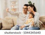 family  technology  parenthood... | Shutterstock . vector #1044345640
