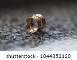 two wedding rings on the table | Shutterstock . vector #1044352120