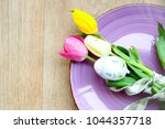 easter background with a lilac... | Shutterstock . vector #1044357718