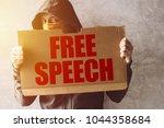 hooded activist protestor... | Shutterstock . vector #1044358684