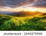 mountain valley during sunrise. ... | Shutterstock . vector #1044375940
