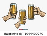 hands holding and clinking beer ... | Shutterstock .eps vector #1044400270