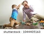 dad spending quality time with... | Shutterstock . vector #1044405163
