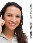 portrait of a brunette smiling...   Shutterstock . vector #104440928