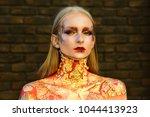 halloween makeup  visage.... | Shutterstock . vector #1044413923