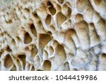 close up erosion holes of... | Shutterstock . vector #1044419986