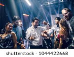 shot of a young man dancing in... | Shutterstock . vector #1044422668