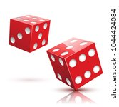two red dices on a white... | Shutterstock . vector #1044424084
