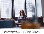 a pretty girl in glasses works...   Shutterstock . vector #1044433690