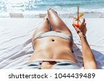 woman with cocktail takes a... | Shutterstock . vector #1044439489