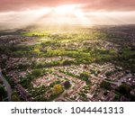 sun bursting through clouds... | Shutterstock . vector #1044441313