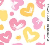 seamless background with hearts ... | Shutterstock .eps vector #1044469438