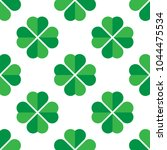 green shamrock seamless pattern.... | Shutterstock .eps vector #1044475534