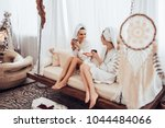 two young women are relaxing in ... | Shutterstock . vector #1044484066