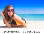 long haired woman in swimsuit... | Shutterstock . vector #1044501139