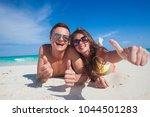 attractive couple enjoying... | Shutterstock . vector #1044501283