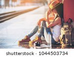 tourist travel woman siting at... | Shutterstock . vector #1044503734