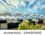 sunshades on luxury beach of... | Shutterstock . vector #1044505600