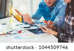 cute creative designers working ... | Shutterstock . vector #1044509746