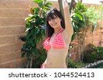 beautiful woman in pink bikini | Shutterstock . vector #1044524413