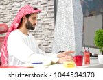 arabian business man working on ... | Shutterstock . vector #1044534370