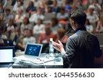 speaker giving a talk on... | Shutterstock . vector #1044556630