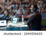 speaker giving a talk on... | Shutterstock . vector #1044556633