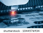 the fiber laser cutting the... | Shutterstock . vector #1044576934
