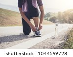 Small photo of Healthy lifestyle, Runner tying running shoes getting ready for race on run track jog workout wellness concept.