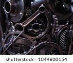 metal cog wheels bonding... | Shutterstock . vector #1044600154