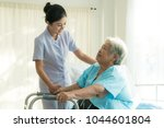 asian young nurse supporting... | Shutterstock . vector #1044601804