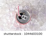 overhead view of a can of soda... | Shutterstock . vector #1044603100