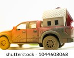 paper home on truck with copy... | Shutterstock . vector #1044608068
