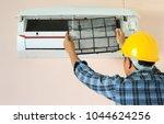 technician man cleaning air... | Shutterstock . vector #1044624256
