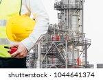 engineering man standing with... | Shutterstock . vector #1044641374