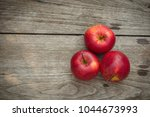 red apples on a wooden table... | Shutterstock . vector #1044673993