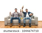 the two guys with a beer watch... | Shutterstock . vector #1044674710