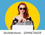 redhead woman in sunglasses... | Shutterstock . vector #1044676639