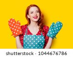 redhead housewife with gloves... | Shutterstock . vector #1044676786