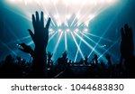 happy people dance in nightclub ... | Shutterstock . vector #1044683830