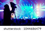 cameraman live streaming event... | Shutterstock . vector #1044686479