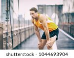 tired runner taking a break... | Shutterstock . vector #1044693904